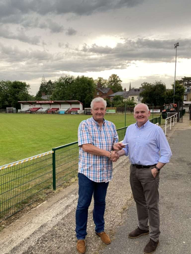 Dorvics Owner, Ashley Lewis and Sean Downey, Director of Football shake on the sponsorship deal at the club.
